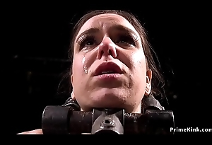 Brunette ass caned fro device bondage