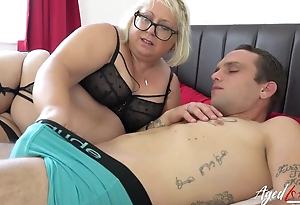 Chubby mature bitch with pierced slit blows younger sponger