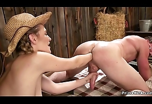 Hot rancher anal fists her on ice in barn